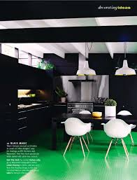 black kitchen with green floors
