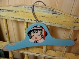older nursery hangars are adorable additions to hold baby s layette or to use for decoration share your vintage nursery hangars here