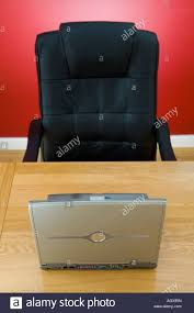 office chair bed. Empty Office Chair In Front Of Desk With Laptop Computer - Stock Image Bed