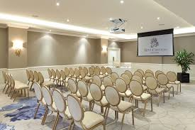the luxurious and elegant business conference rooms. Rows Of Chairs Facing A Drop-down Screen The Luxurious And Elegant Business Conference Rooms