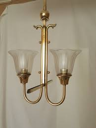 ornate hanging lamp of copper brass with two milk glass shades second half 20th