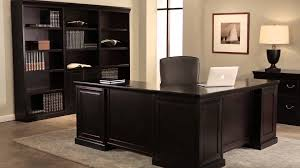 home office black desk. Black Desk And Cabinet Made Of Wood By Kathy Ireland Furniture On Gray Wall Matched With Ivory For Home Office Design Ideas