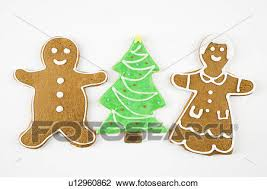 christmas sugar cookie clip art. Modren Art Stock Photo  Sugar Cookie Christmas Tree Between Gingerbread Male And  Female Fotosearch Throughout Cookie Clip Art