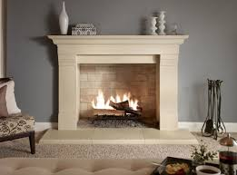 interior white fireplace mantel with brick stone fireplace connected by ceramics flooring and grey wall