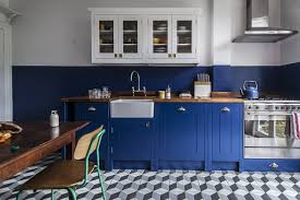 another kitchen by british standard with a colorblock effect painted in deep space blue from