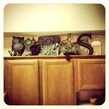 decorating above kitchen cabinets with baskets above kitchen basket decor above cupboard decor ideas on fridge