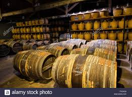 storage oak wine barrels. Hennessy Ageing Warehouse Where The Eaux-de-vie Is Stored In Oak Barrels To Mature Before Blending, Cognac, Poitou-Charente Storage Wine