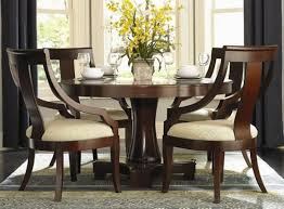 cool round dining table with yellow flower centerpiece plus black bay window curtain also trendy wooden