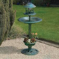 wonderful bird bath design painted in green with three level stage as bird nest