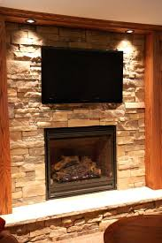 stone fireplace tv mount mounting tv over stacked stone fireplace