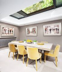 gray and yellow dining room ideas. dining room decor and smart natural ventilation with retractable skylight design wooden table yellow chair furniture gray wall paint ideas