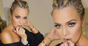 khloe kardashian pulls a pose as she copies sister kim with braids hairstyle mirror
