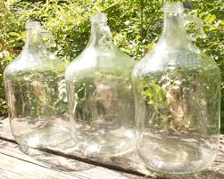 glass jugs with sticky labels removed
