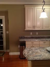 decorative bracket below countertop end tile at end of cabinet and just focus on below extension not keeping this old green paint color