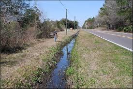 drainage ditch roadside drainage ditch on imeson road jacksonville duval county
