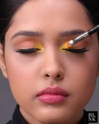how to brighten your eyes with a pop of yellow beauty blink makeup tutorials video