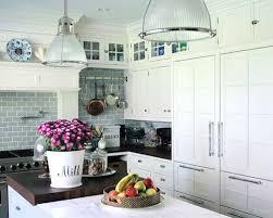 Elegant kitchen photo in New York with shaker cabinets, white cabinets,  blue backsplash,