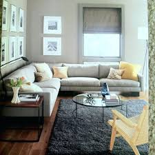 area rugs for dark wood floors grey couch yellow pillows black white photography area rugs dark wood floors