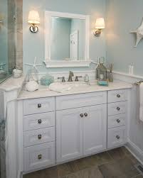 beach theme lighting. Beach Theme Decor For Bathroom In Style With Wainscoting And Baseboard Molding Also Hardware White Cabinets Plus Wall Lighting R