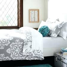 gray and turquoise bedding simple bedroom with grey white comforter sets table suitcase side baby