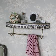 ornate rustic gold wall shelf with rail