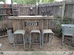 Bar Made Out Of Pallets Rustic Bar Made Out Of Old Fencing Surrounded By Vintage Items