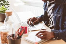 looking for paid writing jobs these sites are hiring right now male writing and working on laptop at home office
