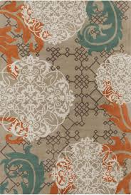 this machine woven rug features a plush pile colors of blue brown this machine woven rug features a plush pile colors of blue brown gold and taupe accent