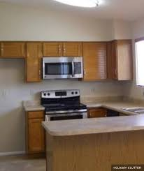 wood cabinets with stainless steel appliances
