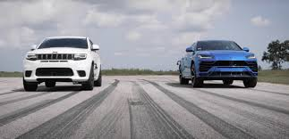 Despite the inherent differences between audi and lamborghini, these sporty choices fall within a close performance margin. Lamborghini Urus Vs Jeep Trackhawk World S Fastest Suvs Drag Race Caradvice
