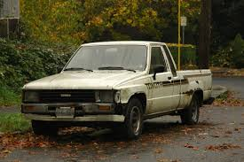 OLD PARKED CARS.: 1986 Toyota Hilux.