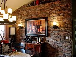 regency stacked stone panels add rich texture a wine themed dining room