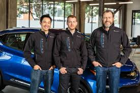 general motors president dan ammann right with cruise automation co founders kyle vogt