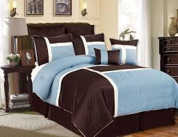 minimalist bedroom with aqua blue tan bedding sets dark brown tailored bed skirt dark