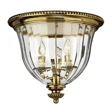 ornate brass flush ceiling light with optic ripple effect glass