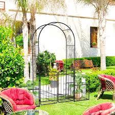 metal garden arch with gate climbing