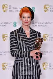 Bafta Award For Best Costume Design Sandy Powell Is Posing Here With Her Award From The 2019
