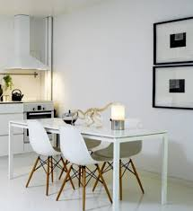 modern white dining table with eames chairs