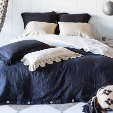elegant nicole miller bedding with black color and black pillow also white panel walls for modern
