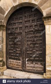 Medieval Doors black wooden medieval doors on an old architectural building stock 2052 by xevi.us