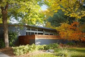exterior wood fences. midcentury modern gray one-story exterior home idea in denver wood fences