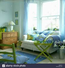 Yellow And Blue Living Room Pale Yellow And Blue Cushions On Sofa With White Loose Cover In