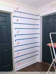how to paint perfect stripes on a wall 5 use painters tape for delicate