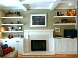 gorgeous monochromatic living room with floating shelves filled filling alcoves on either side of fireplace and