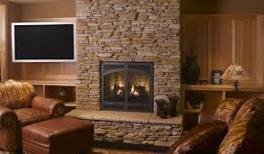 awesome design of the stacked stone fireplace with brown wooden storage added with brown leather seat