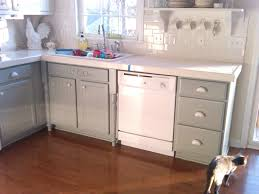 painting door and drawer old oak kitchen cabinet combined with white appliances and white ceramic backsplash for small rustic kitchen spaces with brown