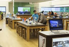 microsoft office building. An Employee Assists A Customer At Microsoft Corp. Store In Bellevue, Washington, Office Building 0