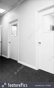 office hallway. Interior Architecture: Black And White View Of Hallway Inside Building With Closed Office Doors Containing E
