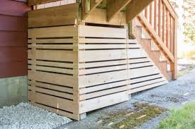 under deck storage area closed off with removable fence panel