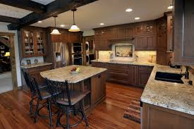 cherry wood kitchen cabinets kitchen traditional with cabinetry faucet front entry